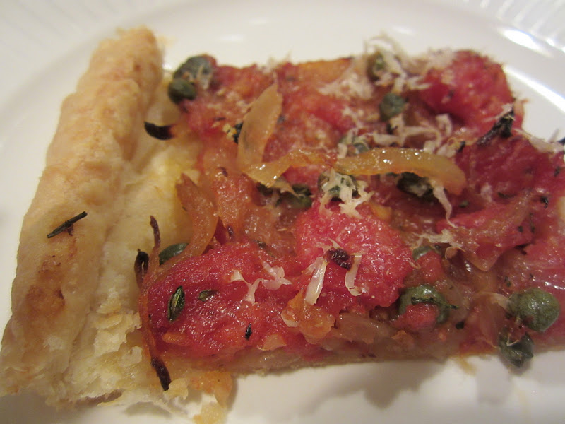 Caramelized onion, caper and anchovy tart