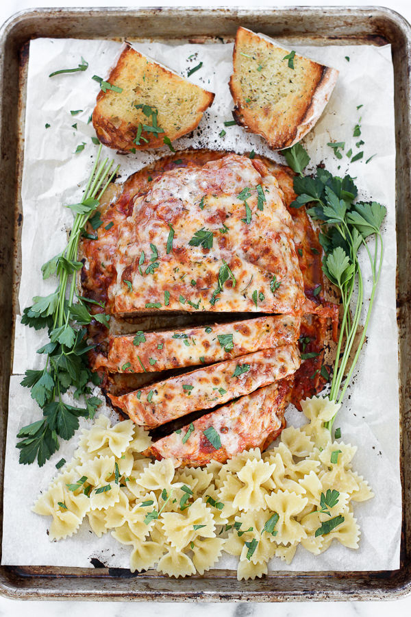 Overhead shot of Italian turkey meatloaf sliced and with pasta and bread