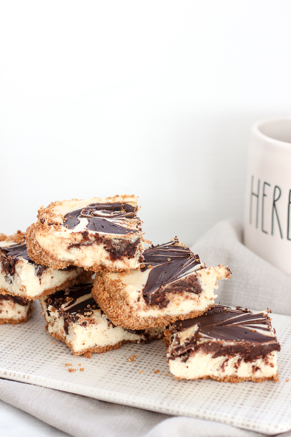 Photo of finished chocolate swirl cheesecake bars cut into squares