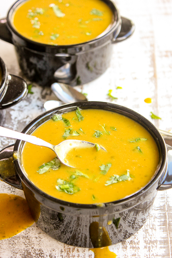 Curried pumpkin soup is rich, creamy and full of perfectly spiced flavor. It's ready in under 30 minutes, making it perfect for quick meals.