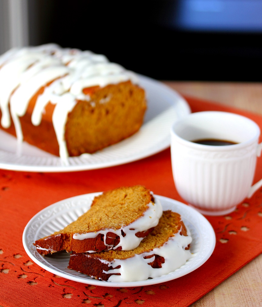This pumpkin bread is incredibly moist and delicious, and a cream cheese glaze makes it over the top delicious! Plus it makes not one, but two loaves.
