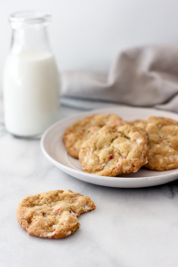 White chocolate candy cane cookies on a plate and milk