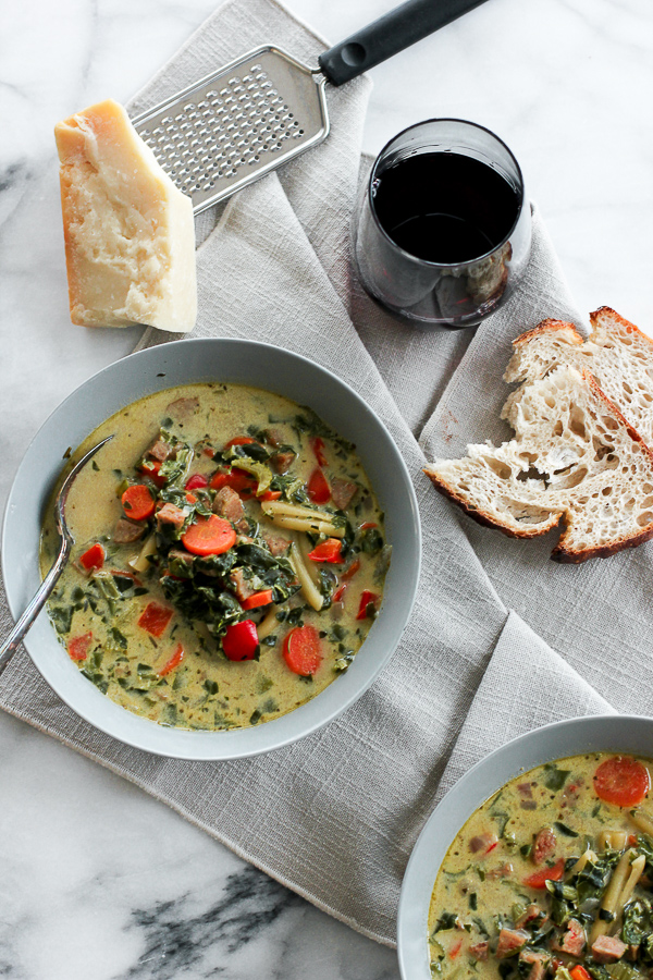 Overhead photo of Creamy Italian Chicken Sausage Soup with bread and wine