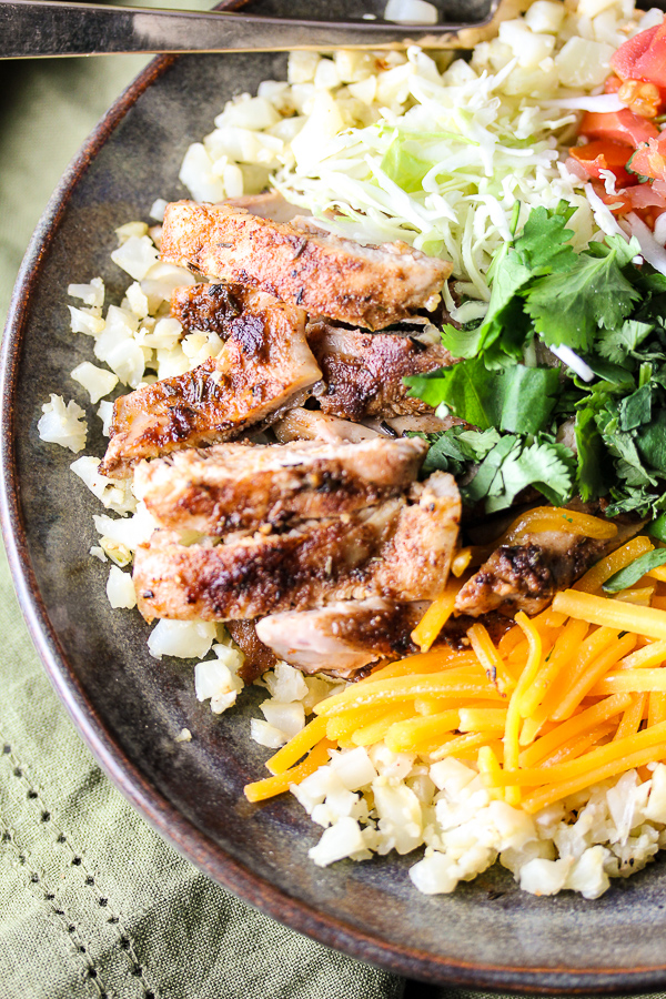 These easy, healthy Jerk Chicken Caribbean Bowls start with a flavorful spice blend and are finished with your favorite fresh toppings. They're family friendly and perfect for busy weeknights.
