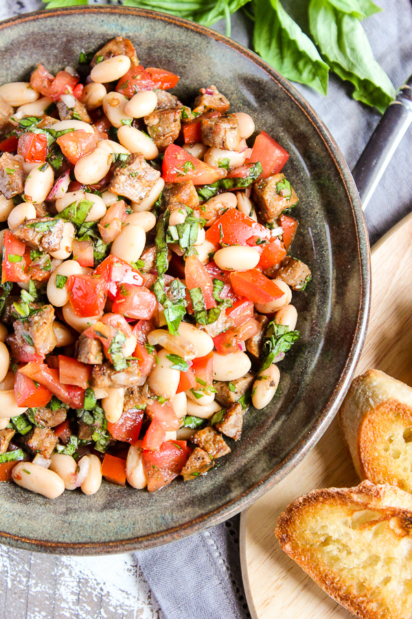 Klement's sausage and white beans combine with traditional bruschetta ingredients to create this mouthwatering Italian sausage and white bean bruschetta.